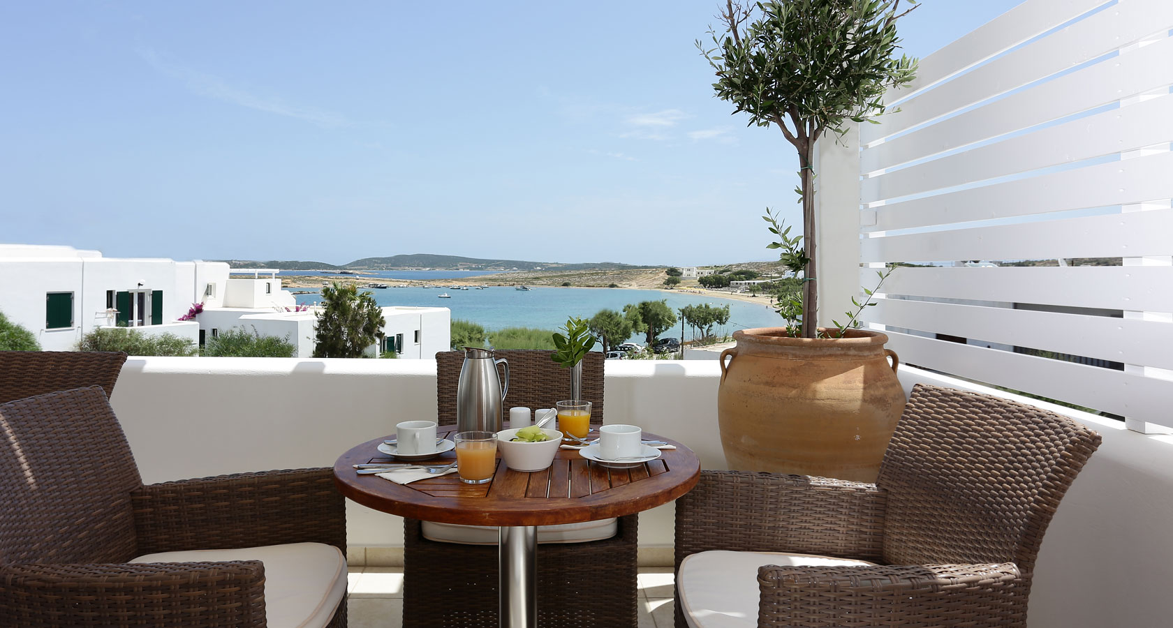 Outdoor breakfast area with sea view